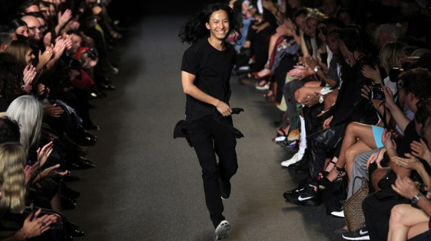 Alexander Wang acknowledges the crowd during his Spring/Summer 2015 collection at New York Fashion Week September 6, 2014 in New York.  AFP PHOTO/Joshua Lott