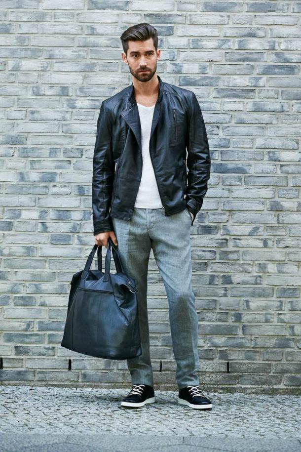 man-with-black-travel-bag